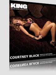 Courtney Black King Magazine cover laying on bed wearing see-thru black bra