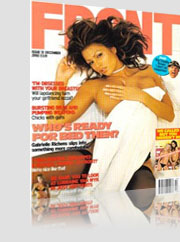 Front Magazine Cover w/ brunette model laying on bed left hand holding breast